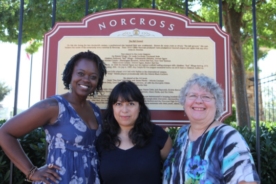 From left to right partners of Norcross Community Market: Sagrdina Jalal, Executive Director of Georgia Farmers Market Association; Karla Blaginin, Primary Analyst, Dichos de la Casa; Connie Weathers, Founder and Chair of Sustainable Norcross