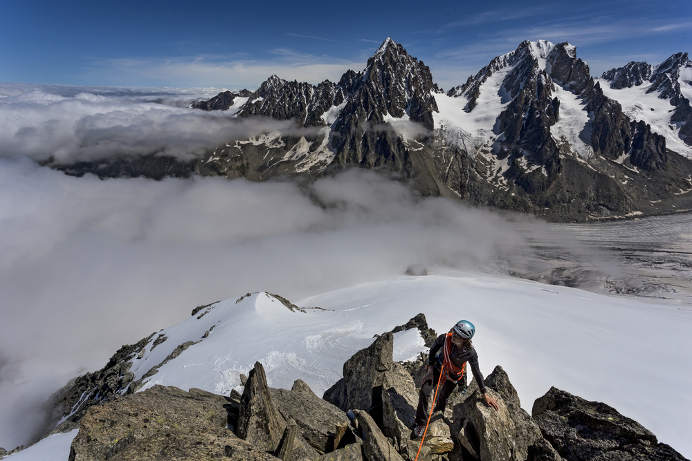 Natalie Berry climbing above the Argentière Glacier and a perfect cloud inversion