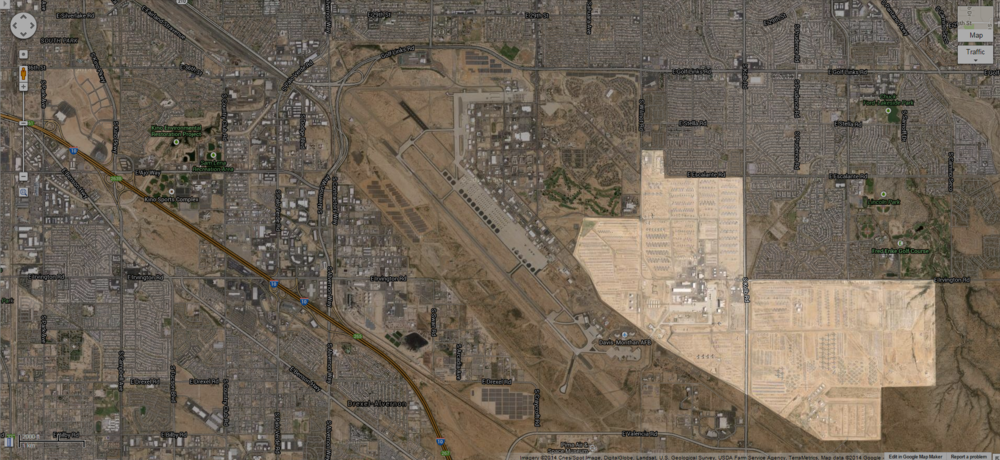 The highlighted area is the boneyard. The building in the middle and airfield is Davis-Monthan Air Force Base. The rest is Tuscon, AZ. For perspective the highlighted area is about 200 acres or .3 square miles.