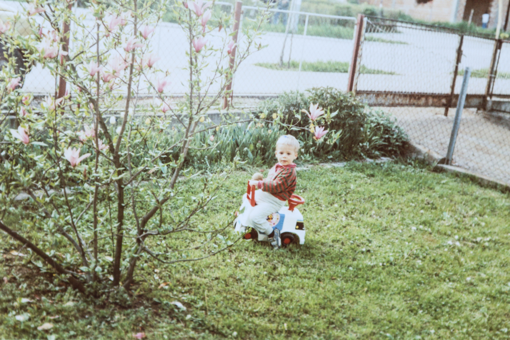 Two-year-old me in our front yard in Bosnia.