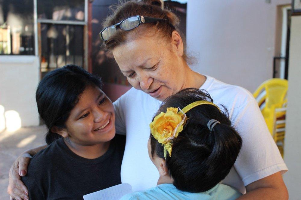 Mama Doris with Alejandra and Denia at the Foundation.