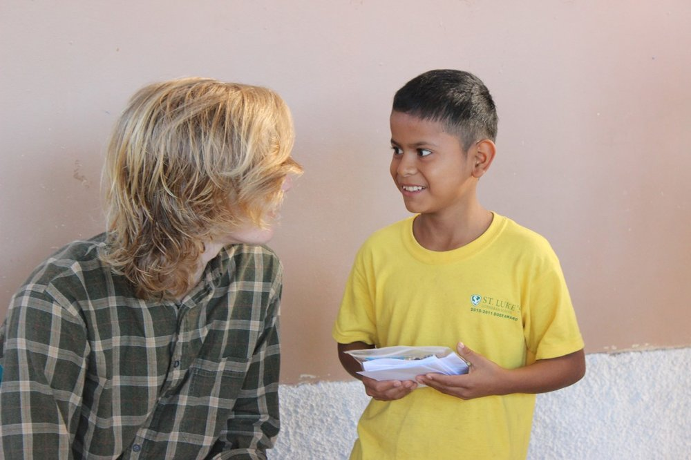 Thomas Simerville talking with Junior (photo by Mallory Lehenbauer).
