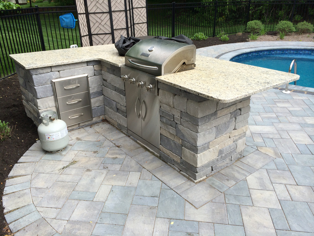 This is another example of a kitchen where we took a standard grill, removed sides, and then installed it into a masonry structure.  Grills like this can be converted to NG or just left as propane.
