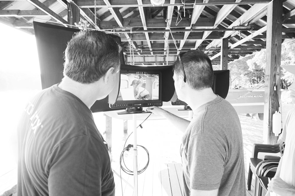 Client and Director reviewing on a video/still production for Coolerbox