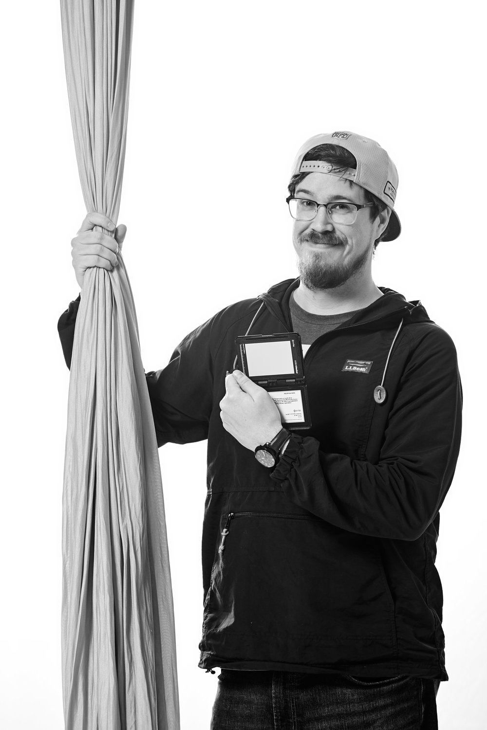 Greg holding a gray card for an aerial portrait session.