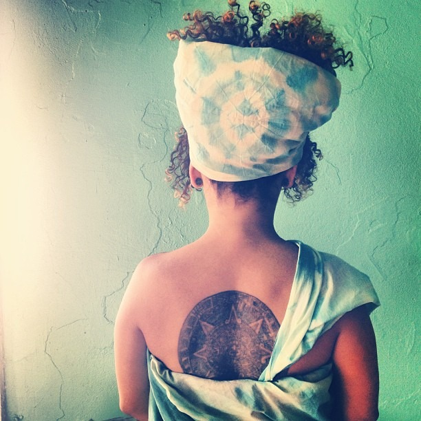 #Shibori #headdress #turquoise #love #Azteccalendar #tattoo #skin #glow #light @sistaeyerie