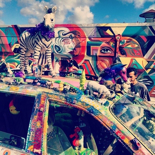@w3rc helping the #art #visitors w directions #pony #unicorn #glitter #artcar #streetart #streetphotography #wynwood #miami #artbasel  #colorporn #psychedelic #travel  (at Wynwood Arts District)