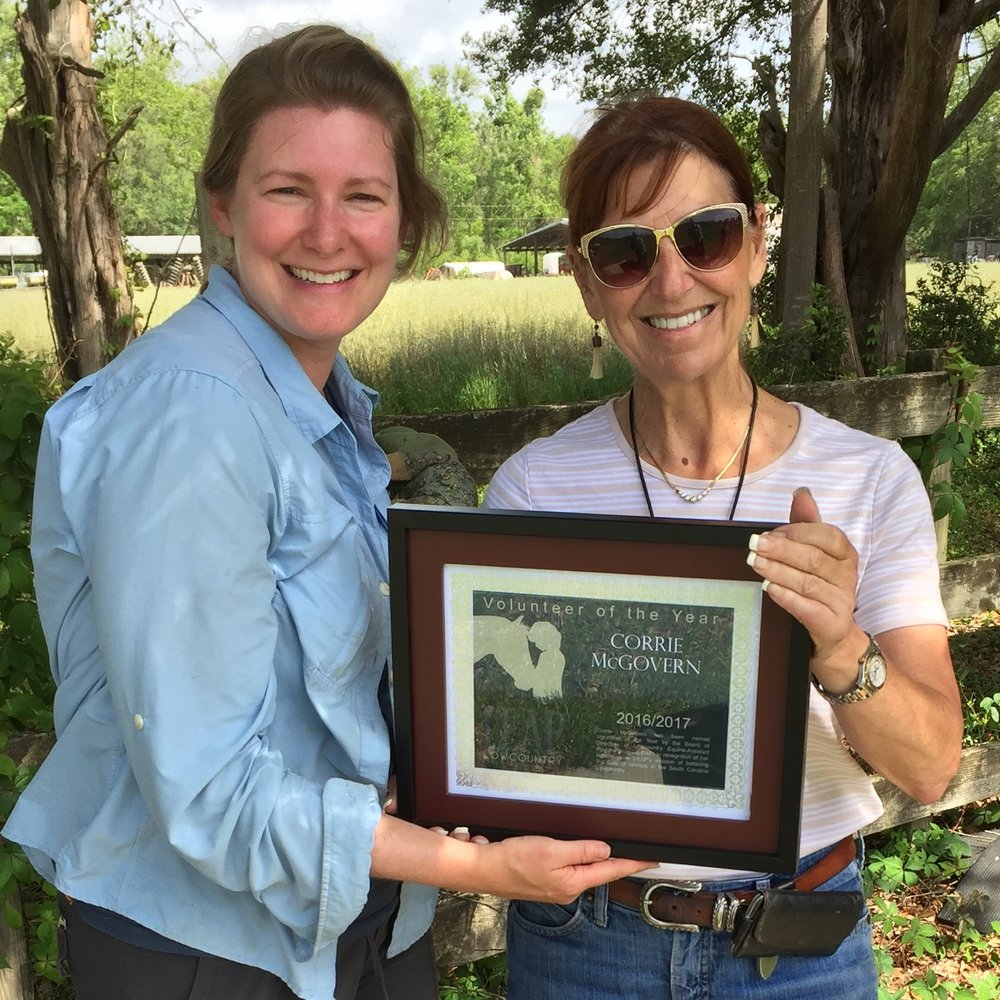 VOLUNTEER OF YEAR 2016 ~ Corrie McGovern of MCG Photography   Corrie wears many hats for LEAP, from regularly volunteering, picking up extra shifts, coordinating Day of Caring Events and scheduling hoof trimming! She is our resident photographer and the keeper of our website! We are so grateful to have her as a part of our volunteer team and we cannot thank her enough for all she does!