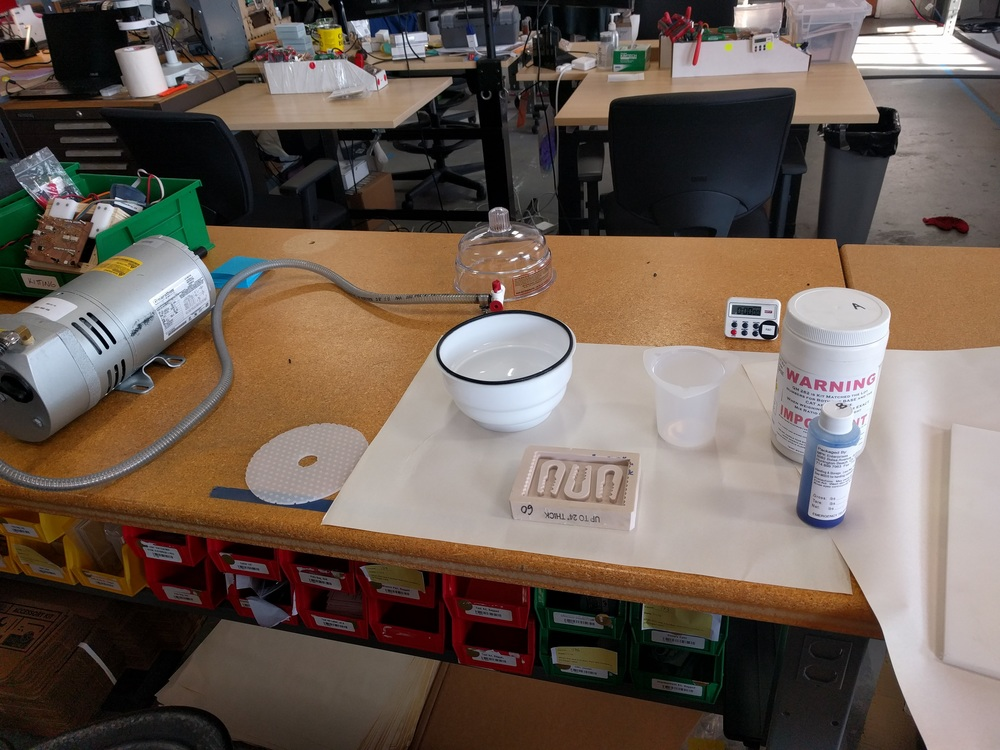 Here's what the setup looks like. Not pictured: gloves, mold release spray, popsicle sticks and a scale. For the silicone molds, I'm using Quantum Silicones QM 262, based on suggestions in the fantastic Resin Casting guide by Michal Zalewski. It has a long pot life, so it's easy to work with - this gives you plenty of time to adequately stir the mixture (important!) and properly degass it in the vacuum chamber.