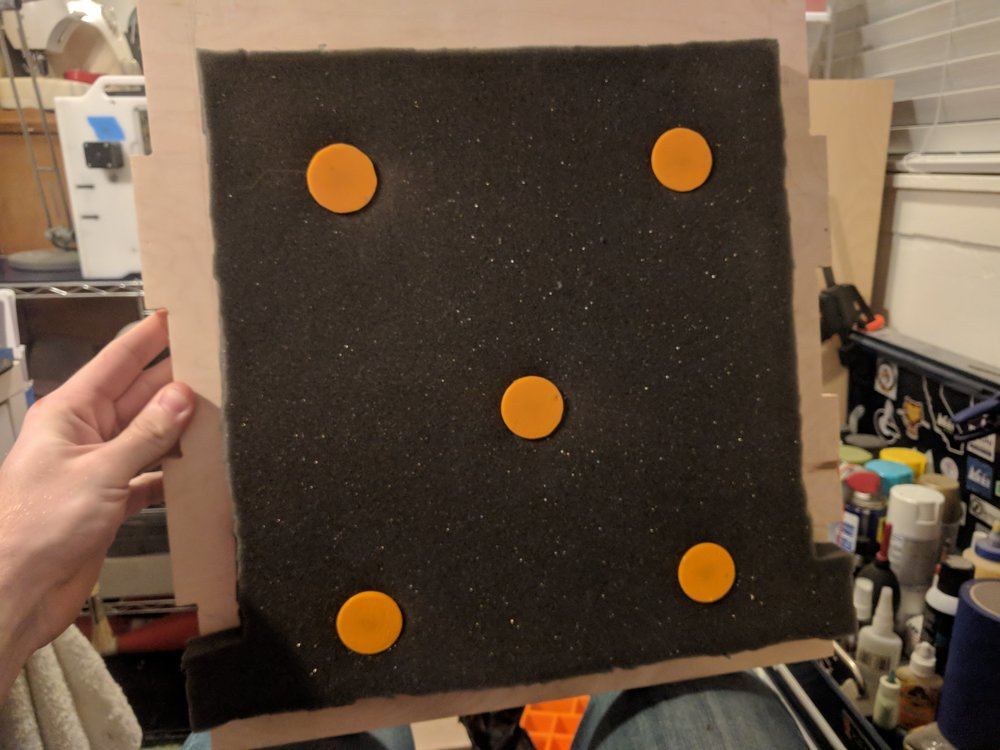 One of the panels with sound-dampening foam installed. The orange parts are 3D Printed with an M4 threaded insert installed for fastening to the wood.