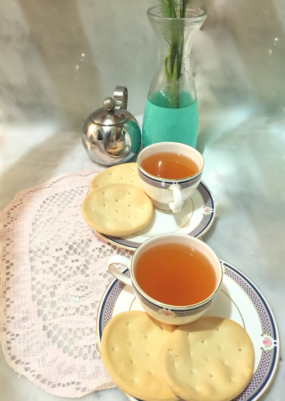Comfort tea served with biscuits or cookies