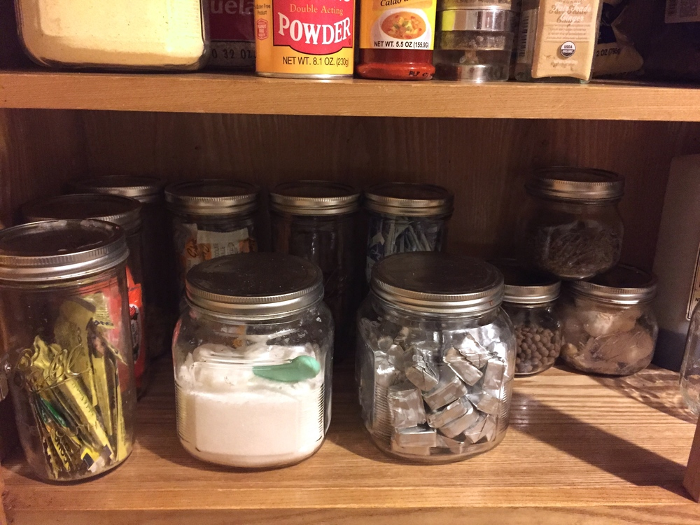 Cabinet items organized inside clear glass jars