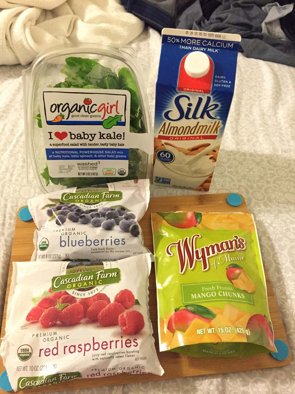 ingredients for the mango berry green smoothie - kale, berries, almond milk, mango