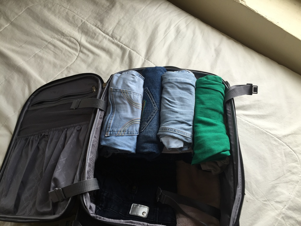 Roll jeans up in your carry on to make your luggage lighter