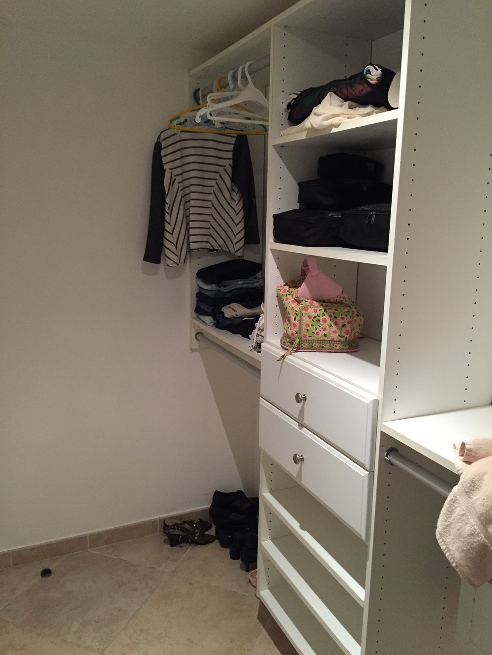 This is the walk in closet at the house I was staying at during vacation. An example of how organized and clutter free one can actually be.
