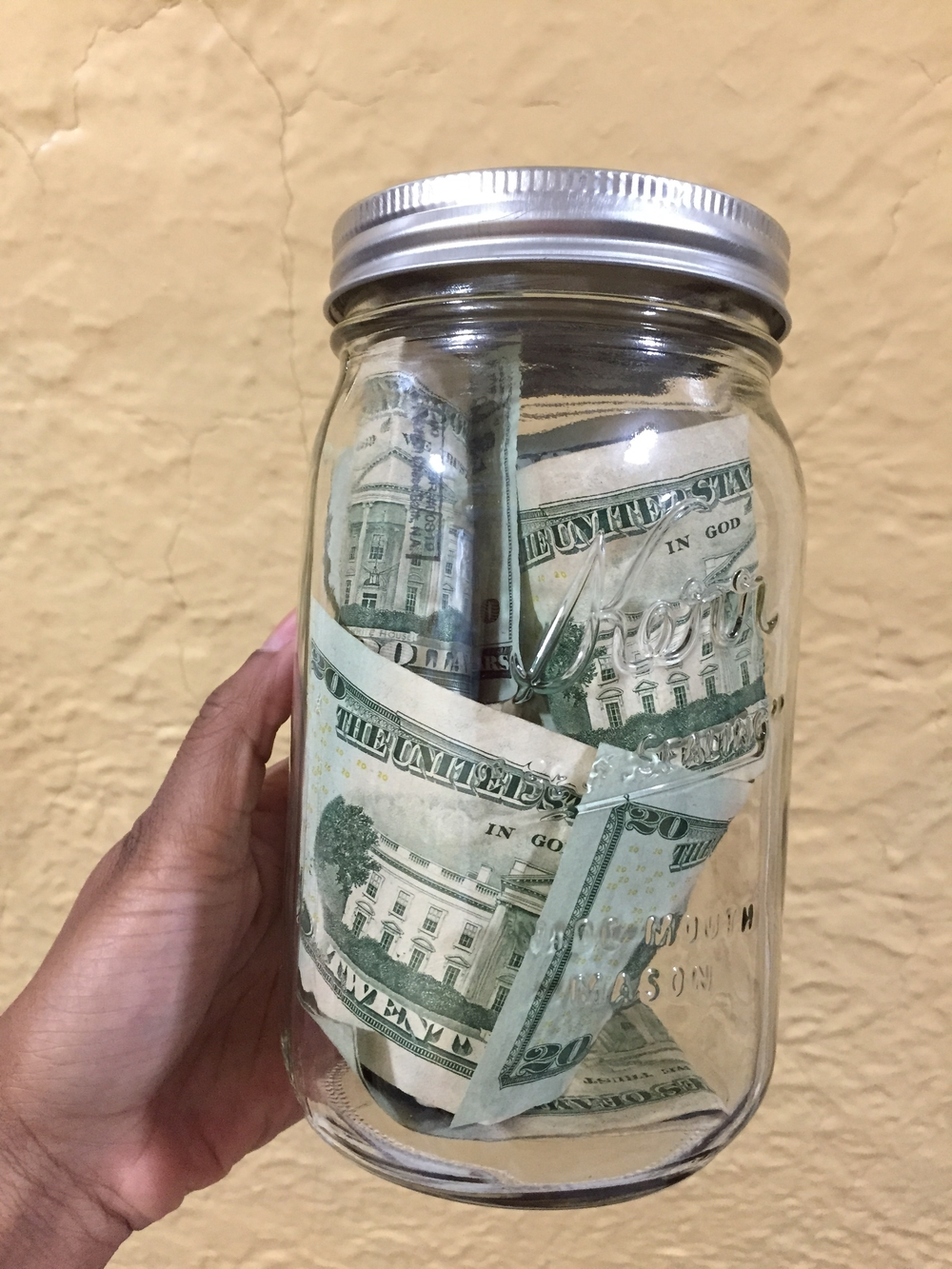 My version of a piggy bank.  Dollar bills in clear glass jars.