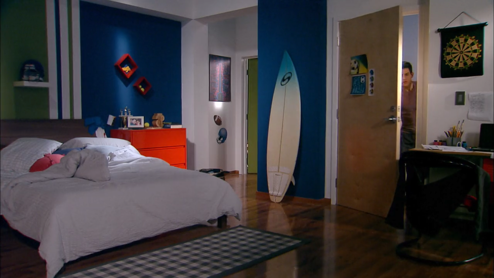 Football and surfing themed bedroom