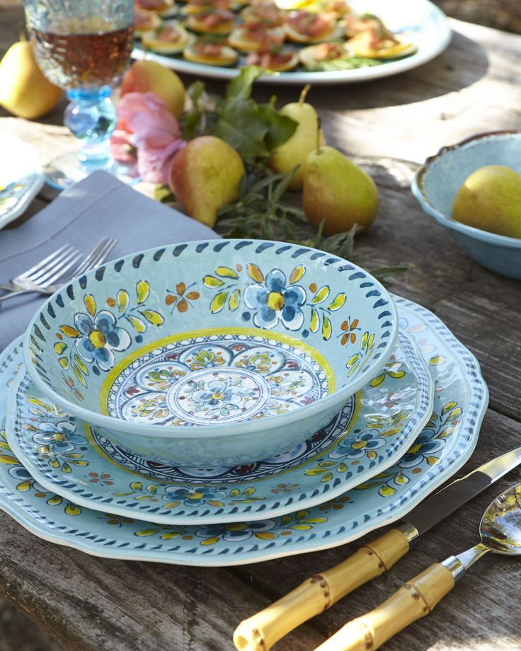 This beautiful set of dinnerware is not ceramic or glass, but of triple-weight Melamine, a very durable, virtually indestructible material, ideal for your picnic.  Find them at your local home-store.