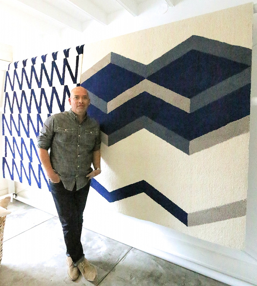 This is Peter posing with his gorgeous rugs.  Are they not so chic and beautiful?  I'll get one of each, please!