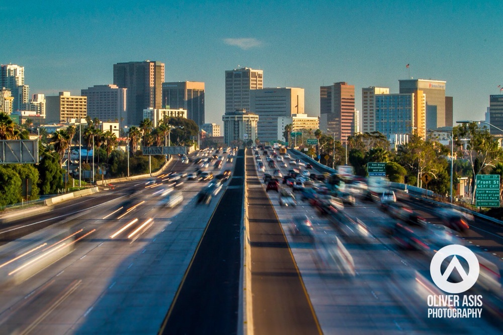 Interstate 5 traffic moves in and out of downtown San Diego during rush hour.