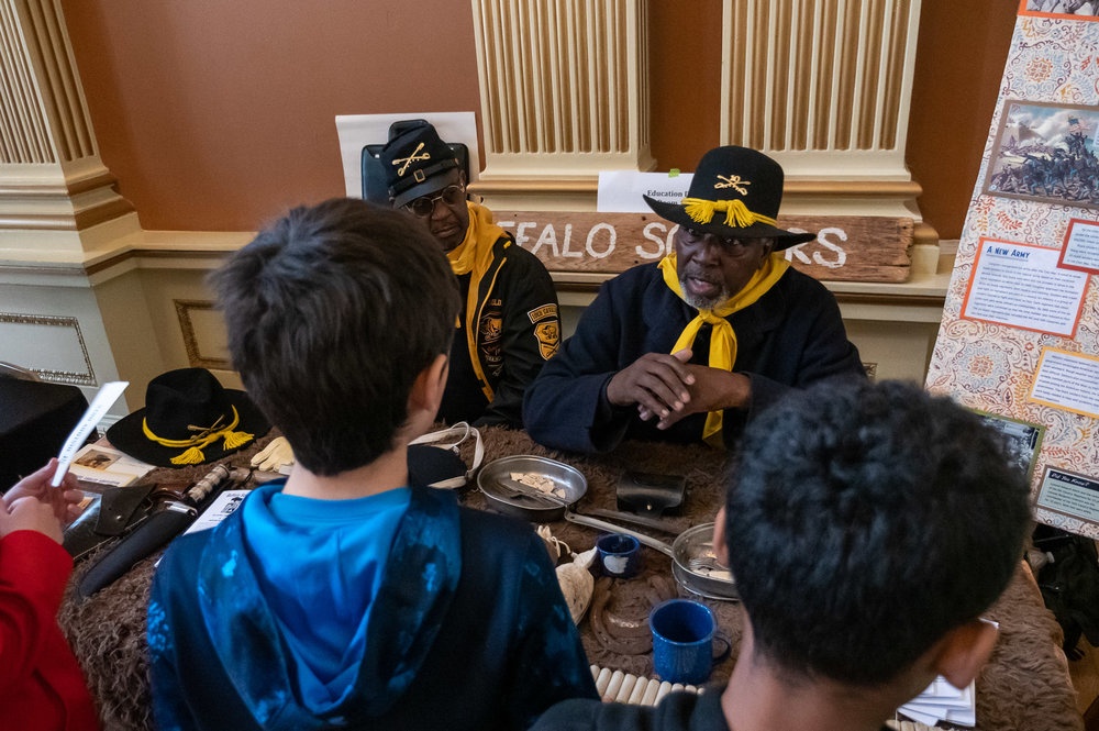 Trooper William Terrell of the 10th Calvary, Company G of NorCal tells students about the Buffalo Soldiers and the mission of their living history group.