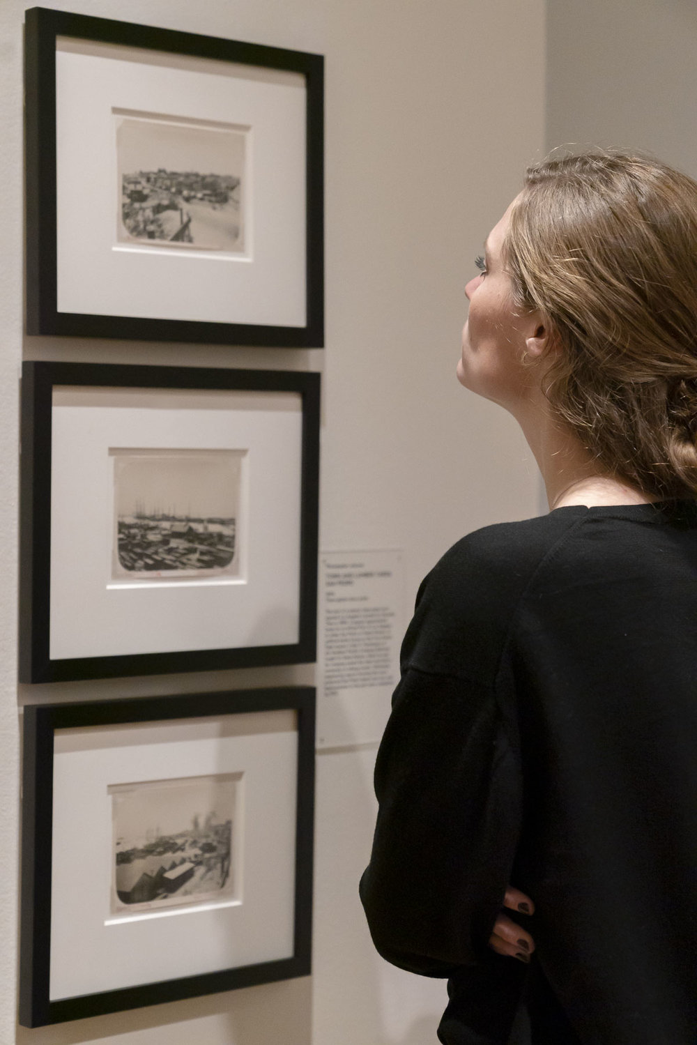 """Art and history lovers attend the opening of """"Boomtowns: How Photography Shaped Los Angles and San Francisco,"""" at the California Historical Society Gallery."""