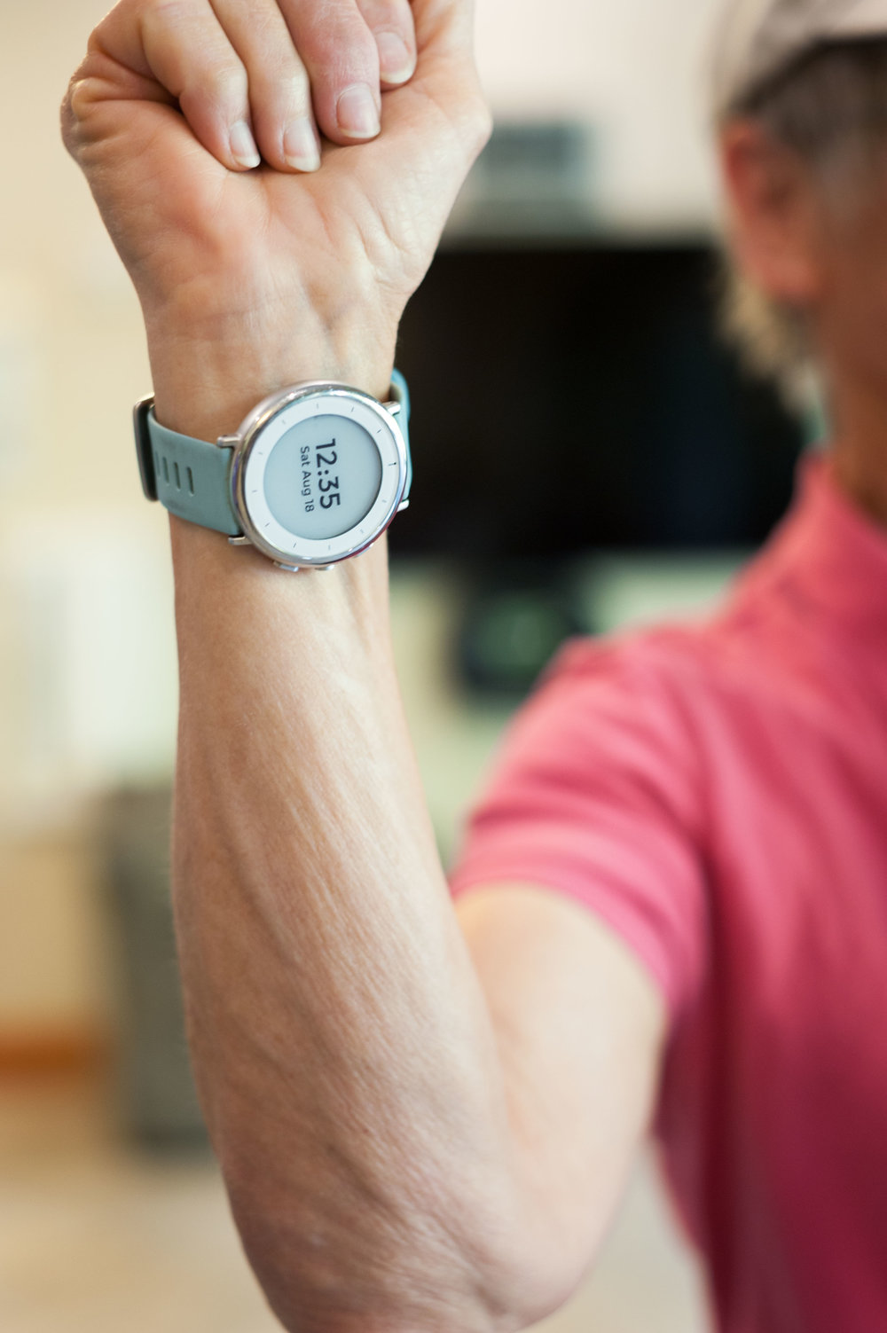 A participant in Stanford University's Project Baseline Study shows off her investigational study watch, designed to monitor her sleep and activity.