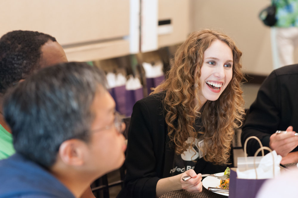 Event organizers enjoy a meal with study participants at the Stanford University Project Baseline Anniversary Event.