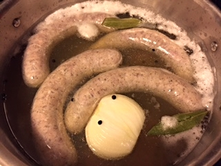 Poaching liquid: half beer, half water, some peppercorns, garlic, bay leaves and onion