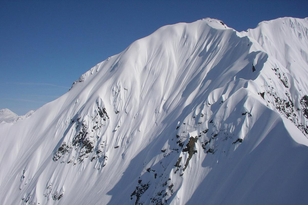Western Chugach Mountains which offer you with more powder than you can ski in one trip.