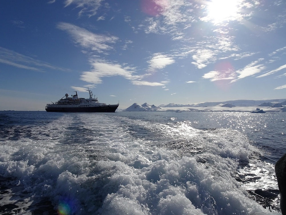 Our Boat in the Unquestionable Beauty of Antarctica.