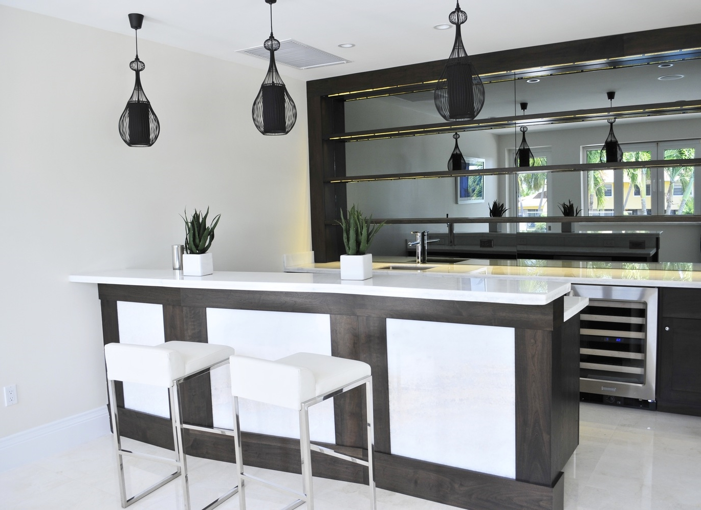 Why design and build is a good fit for cayman cornerstone group we used a translucent marble for the tops and also incorporated that to the bar front malvernweather Image collections