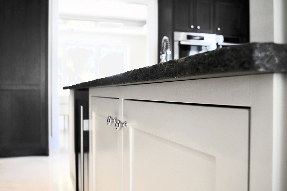 Hand painted cabinets with a chilled edge granite top.jpg