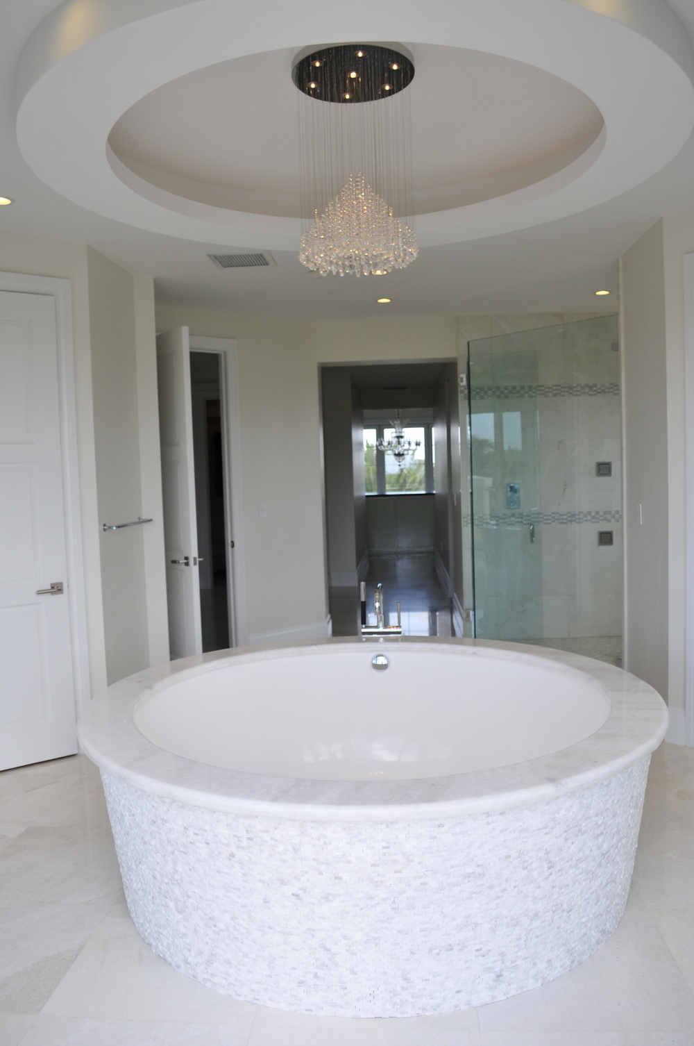 We made a custom bathtub so we could match the circumference of the traced ceiling above finished with a custom crystal chandelier..JPG