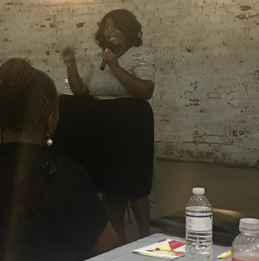 Tammy Charles presenting at the EKHOS Conversation & Cocktails: Combating Imposter Syndrome at the Rialto Theatre in Tampa and August 8, 2018