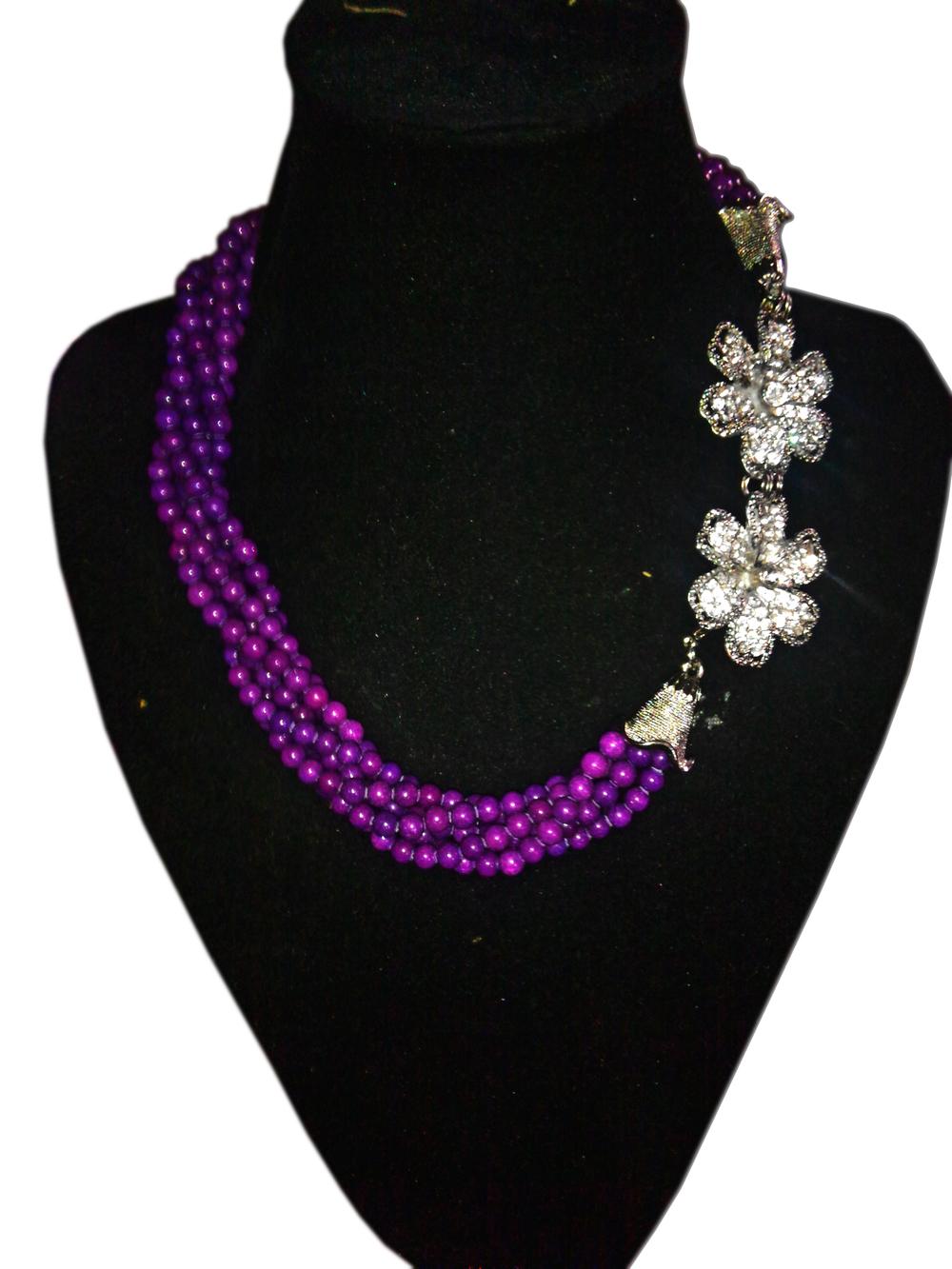 purple twisted bead with flower pendant.jpg