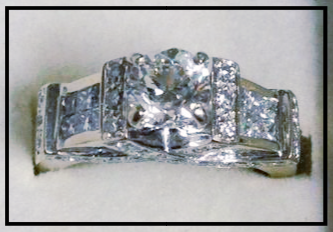 1.9CT in diamonds in total (.90CT center stone) $4,595