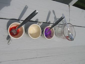 Step 3: The three tea cups of dissolved sodium alginate are colored as follows: red food dye (left), uncolored (middle), purple Crayola Kid's Paint (right).