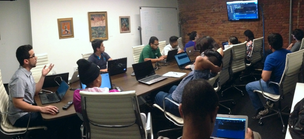 Jorge teaching new students to code at HQ Raleigh.
