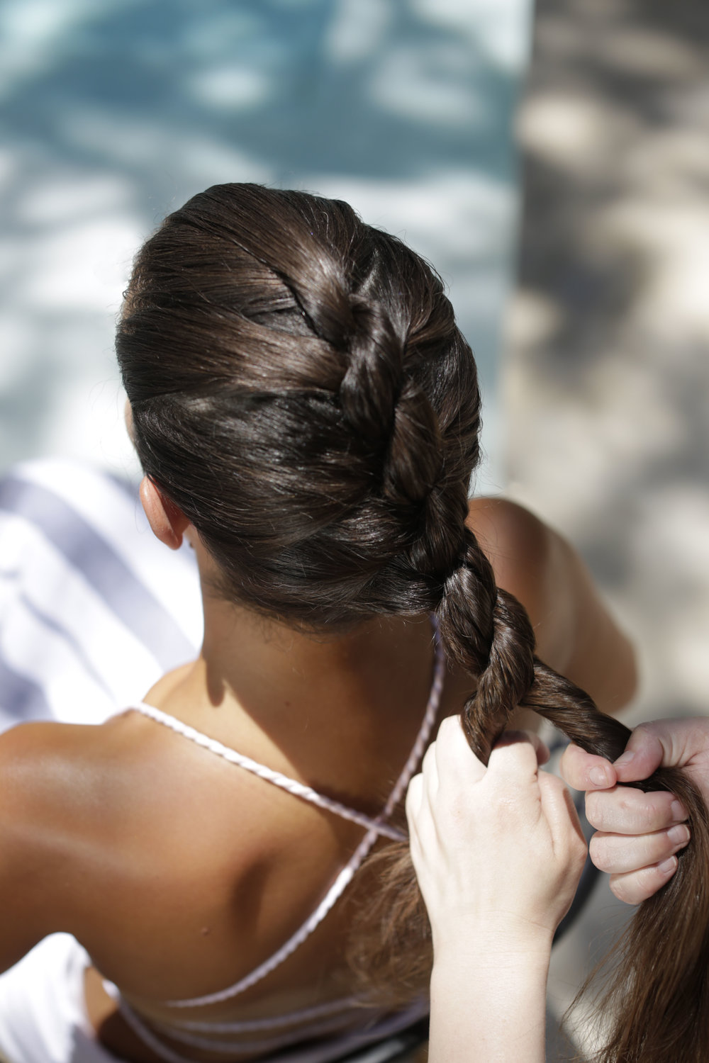 - As you twist the hair clockwise wrap each strand around each other creating the rope braid