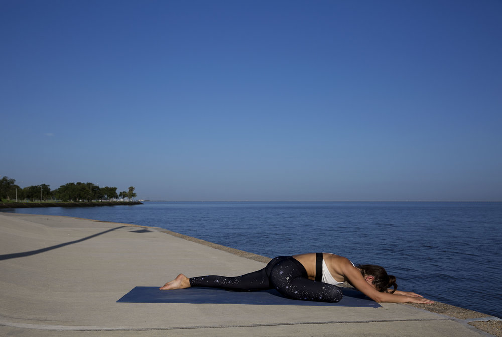 Take a big inhale and crawl the arms out letting your body give way to gravity. Stay for 5 breaths.