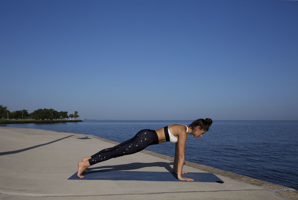 Exhale back into plank, keep exhaling into chaturanga