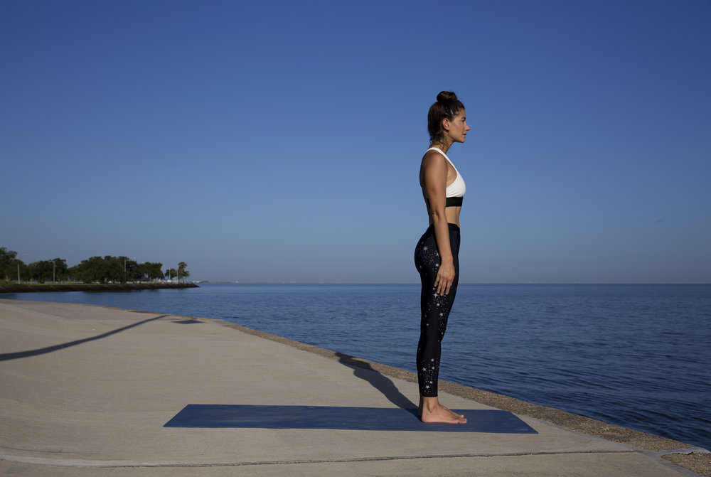 After sun salutations, find your way back to standing pose.