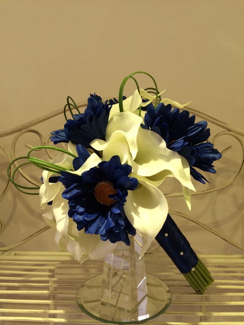 Brides Handtied Bouquet With Ivory Calla Lilies, Royal Blue Gerberas & Looped Over Beargrass