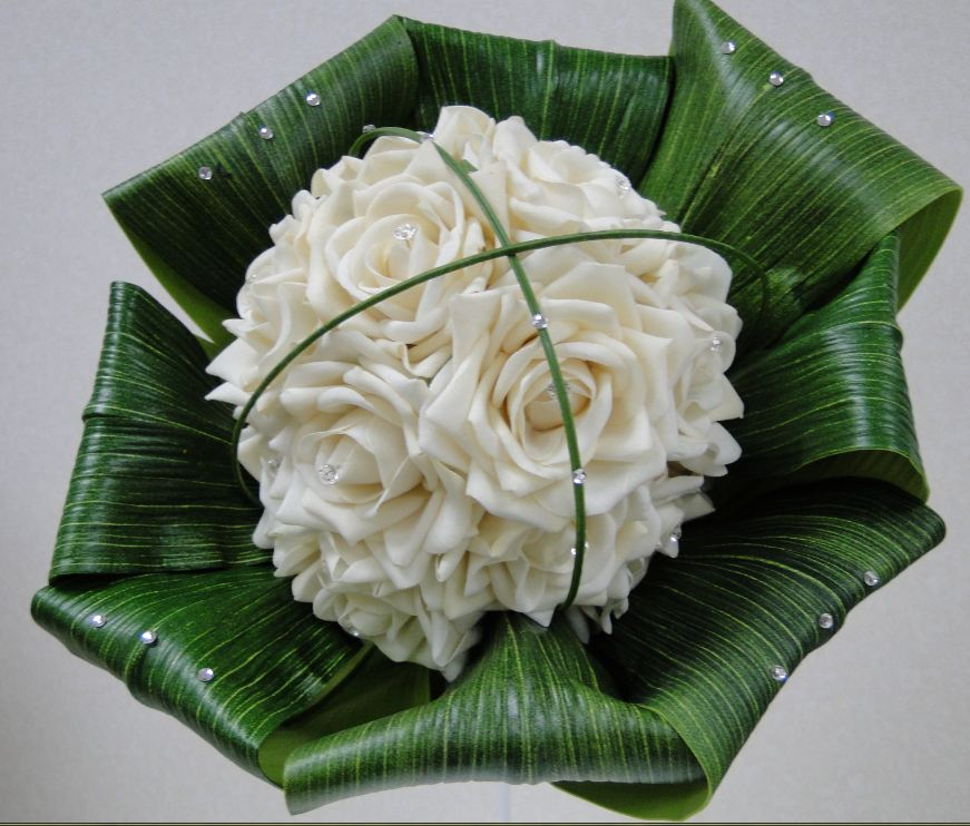Brides Handtied Bouquet With Ivory Roses, Folded Back Aspidistra Leaves & Crossed Over Beargrass