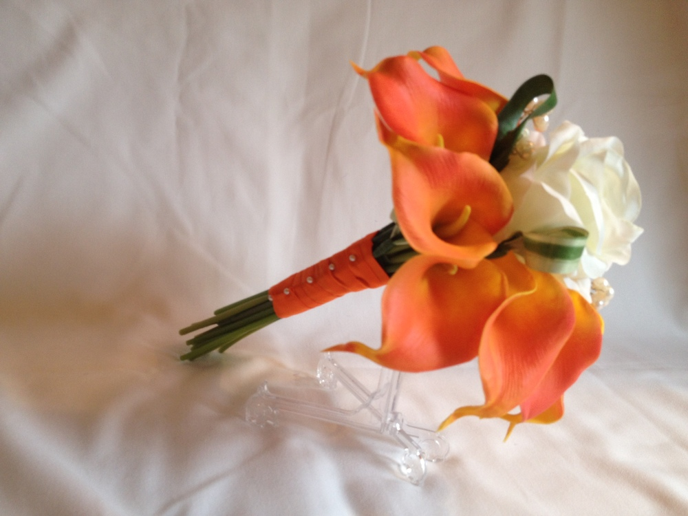 Bridesmaids Bouquet With Orange Calla Lilies, Cream Rose & Looped Back Aspidistra Leaves