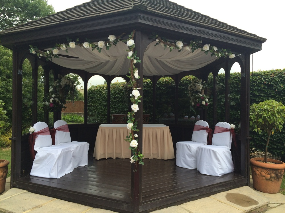 Ceremony Flowers - Garlands Attached to Gazebo, Cream Rose Display