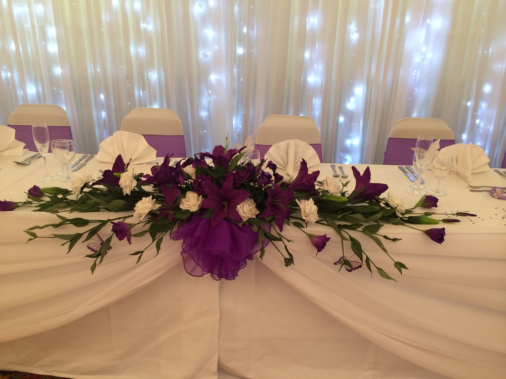 Top Table Display - With Cadbury Star Gazer Lilies, Cadbury Purple & Ivory Roses
