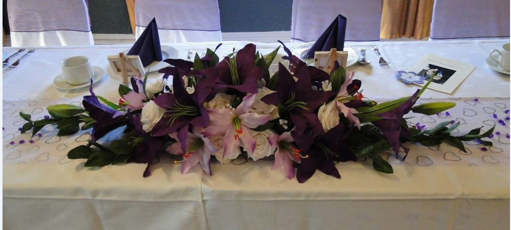 Small Top Table Display - With Purple & Lilac Star Gazer Lilies & White Roses