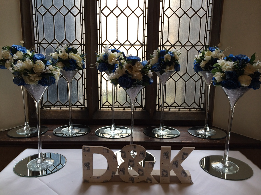 Guest Table Arrangement - 50cm Tall Cocktail Glass, With Crystals In Base, With Small Dome Display Flowers, Light, Dark Blue & Ivory Roses